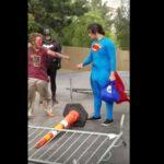Superman beats up a bum on Las Vegas Strip.