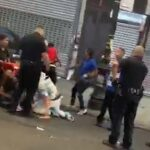 Footage shows NYPD Standing Around watching street fight