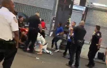 Footage shows NYPD Standing Around watching street fight.