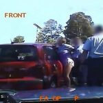 Cop slams a woman's head into car while arresting her for swearing near a school.