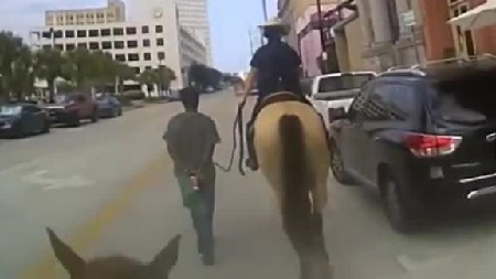 Bodycam of Texas officers on Horseback leading black man by rope released.