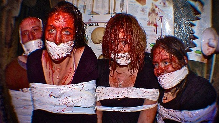 The scariest haunted house in the united states says that they'll pay you 20,000 if you make it through.