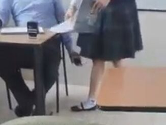 Teacher caught filming under students skirt.