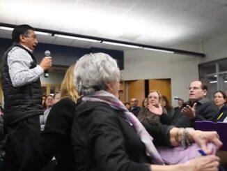 Parent Racist Remark Interrupts school meeting.