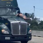 Florida Man Hangs On To Moving Semi-Truck Hood For Miles.