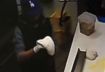 Man makes himself a pizza during robbery at restaurant.