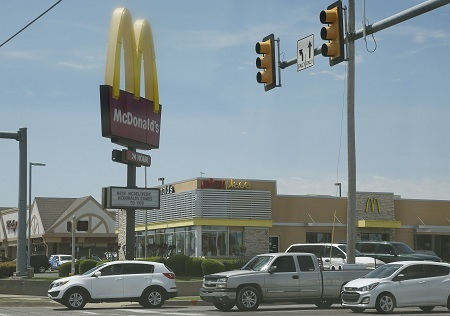 Missouri man charged for fatally shooting his friend inside a McDonald's bathroom.