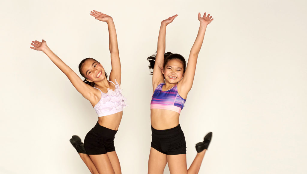 Dancers jump for joy in jazz class