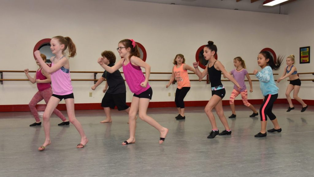 Pre-teen dancers take jazz class