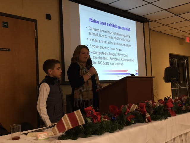 Farm City Banquet youth talking about raising animals