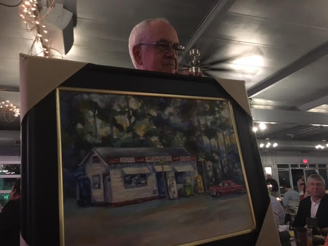 Mac Campbell holding Kathy Bunn Painting at Bladen We Care