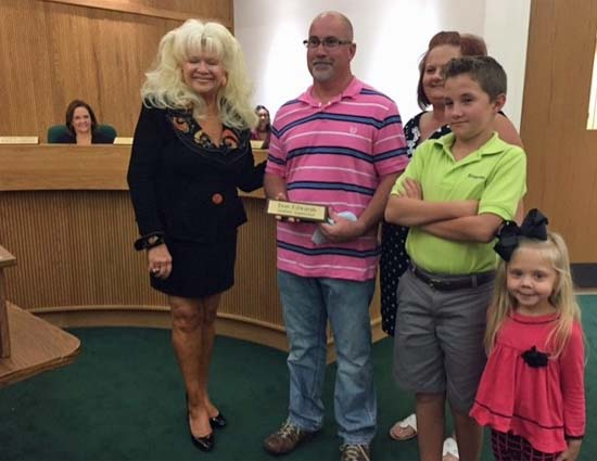 Elizabethtown Utilities Supervisor Don Edwards with his family and Mayor Campbell