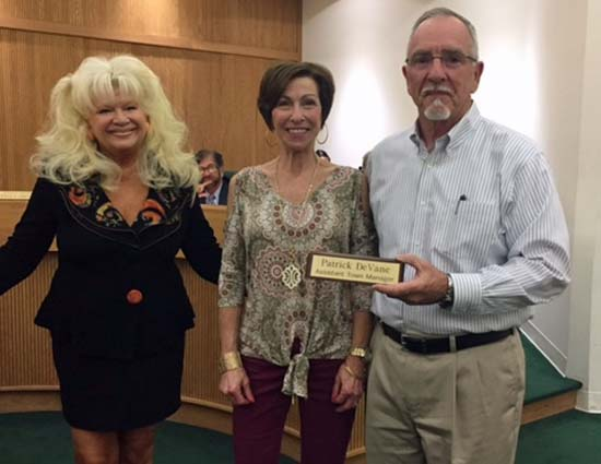 Elizabethtown Assistant Town Manager Pat Devane, his wife and Mayor Campbell