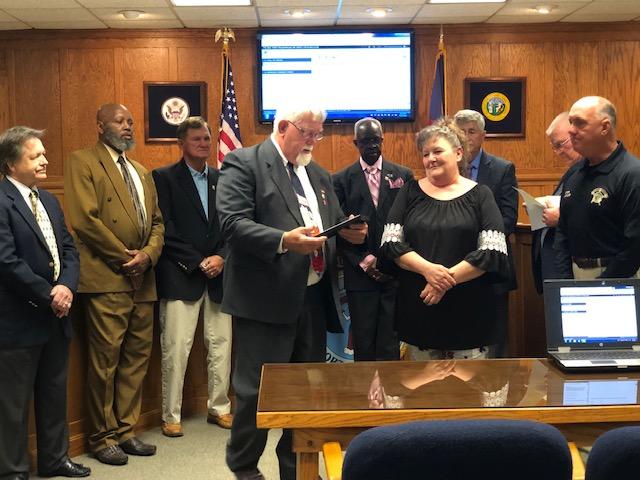 Commissioners Sonya Heustess