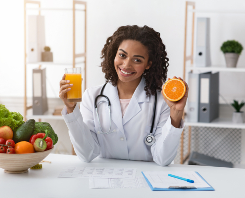 Registered dietician holding orange