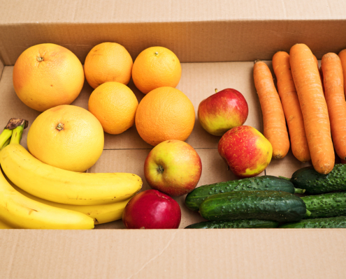 Cardboard Box With Fruits And Vegetables.