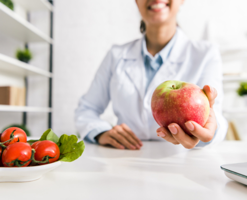 Dietician holding an apple