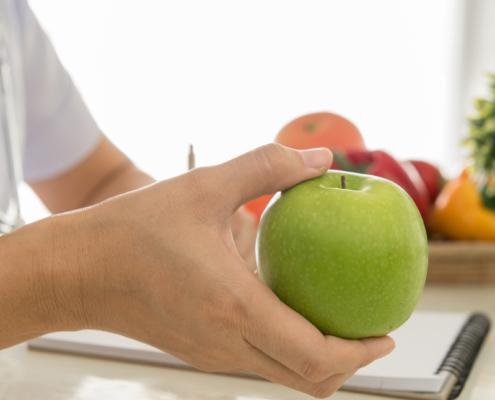 Dietitian holding an apple