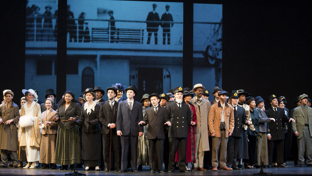"""GCTC's cast of Titanic stand on the deck of the ship in the opening number """"Farewell Titanic"""""""