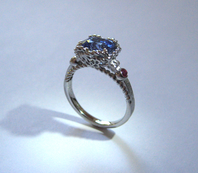 19k white gold ring with sapphire and ruby