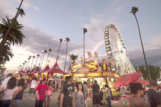 The LA County Fair entered its 90th year running over Labor Day weekend and will extend through September. The annual Fair is cited as the nation's largest county fair with an estimated attendance of more than 1.4 million people.  The fair is lined with hundreds of food  and game vendors in the carnival neighborhood of the fair.