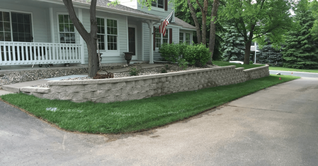 front entry landscaping with retaining wall