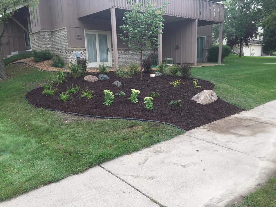 mulch and new plantings installed with edging