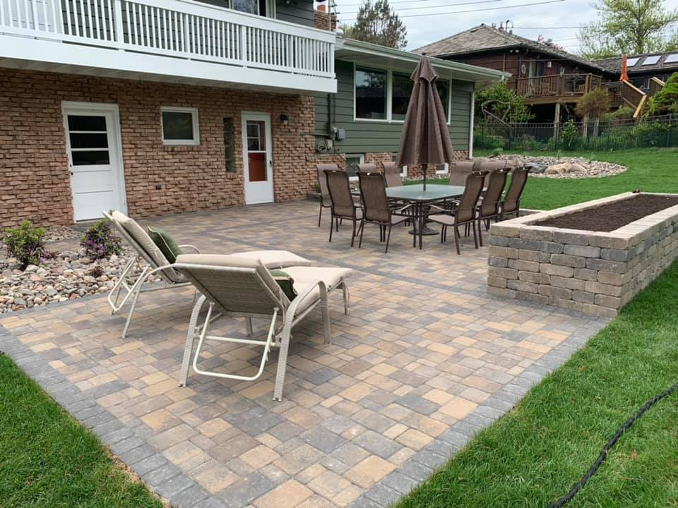 custom paver patio with fire pit and raised garden