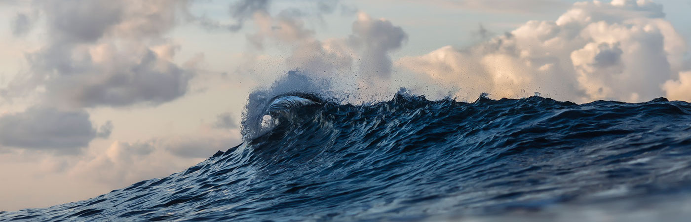 ocean wave with sky in background