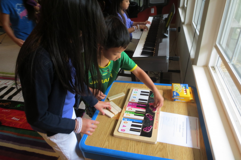 Working together to complete the piano puzzle.