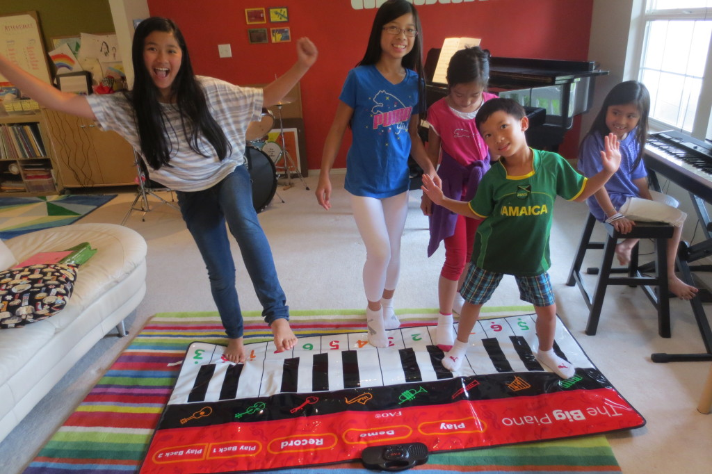 Playing on the big floor piano.