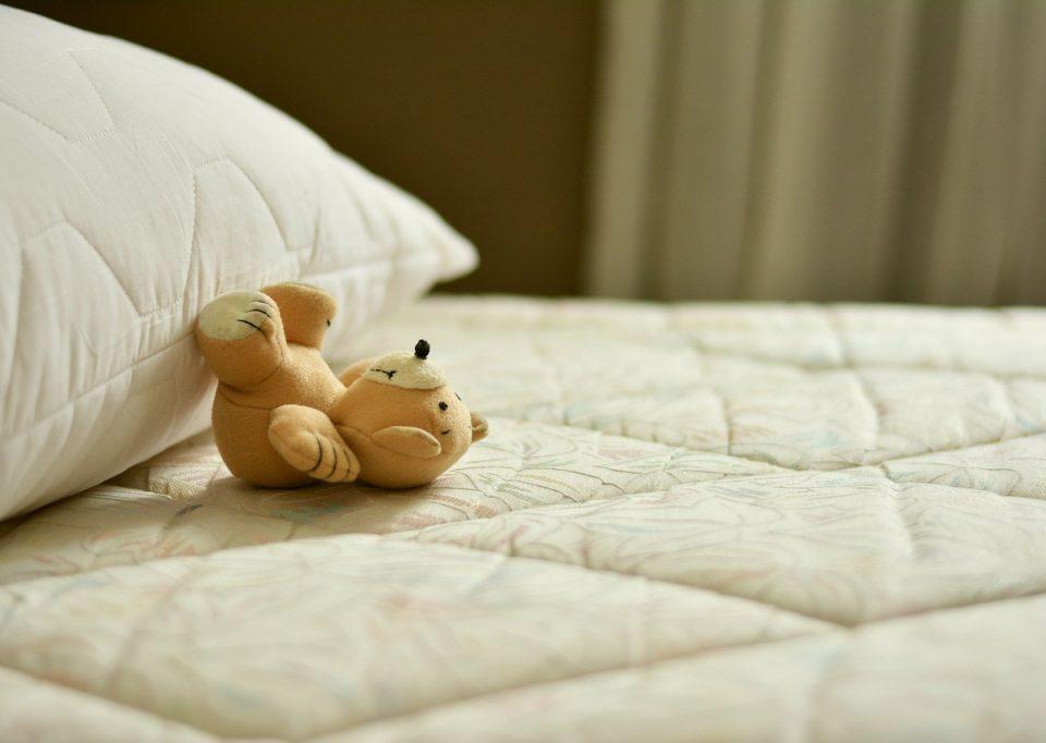 Stuffed bear on bed