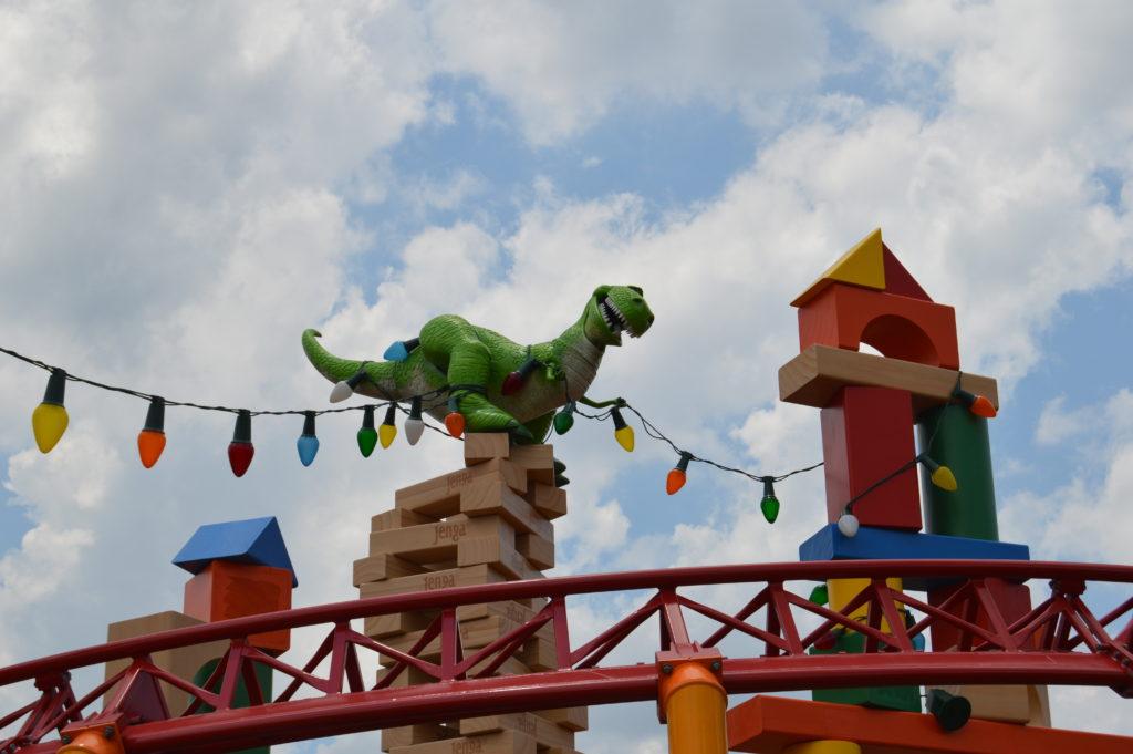 Rex above Slinky Dog Dash roller coaster