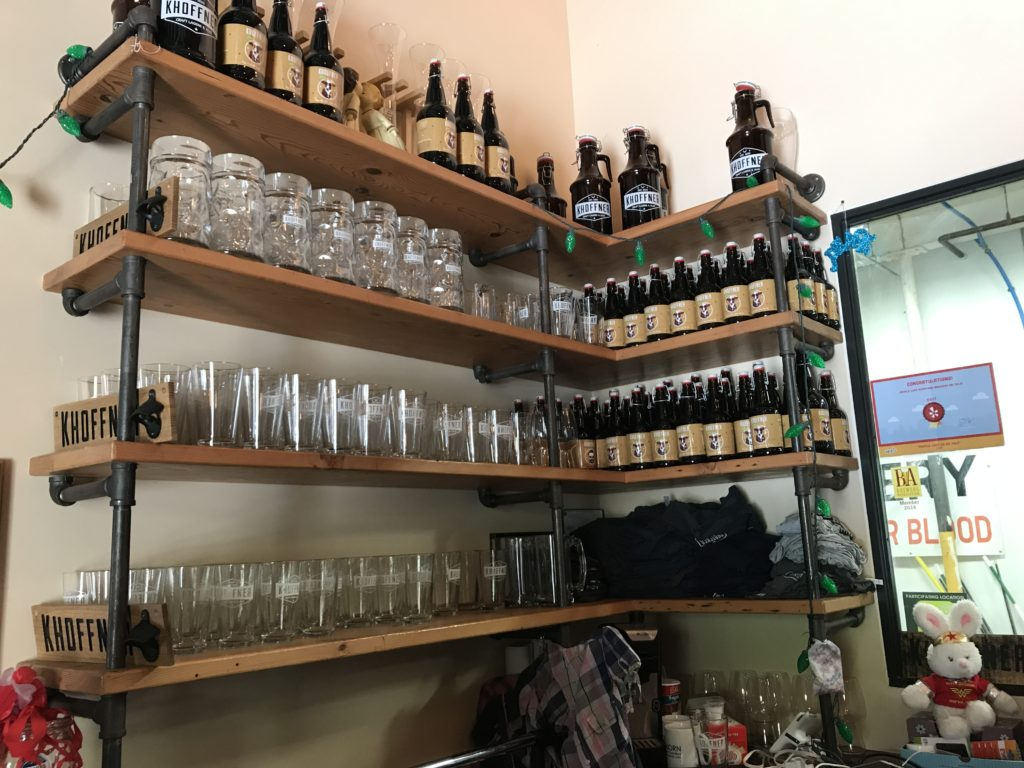 Shelves with pint glasses and beer bottles