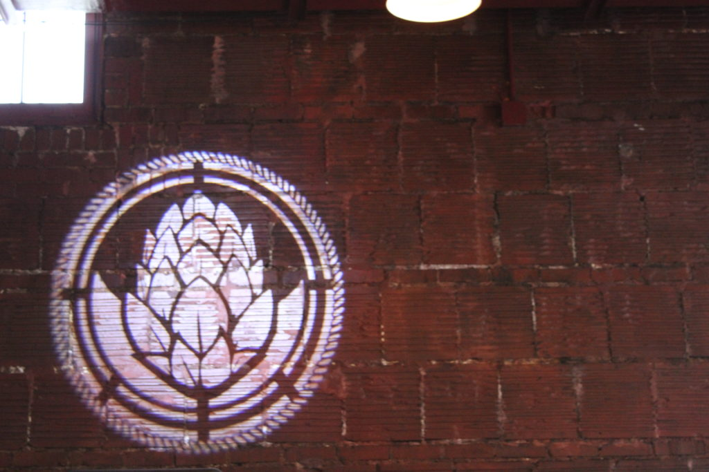 Brick wall with Hops logo