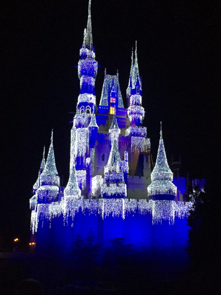 Magic Kingdom Cinderella Castle  lit up at Christmas while hotel hopping