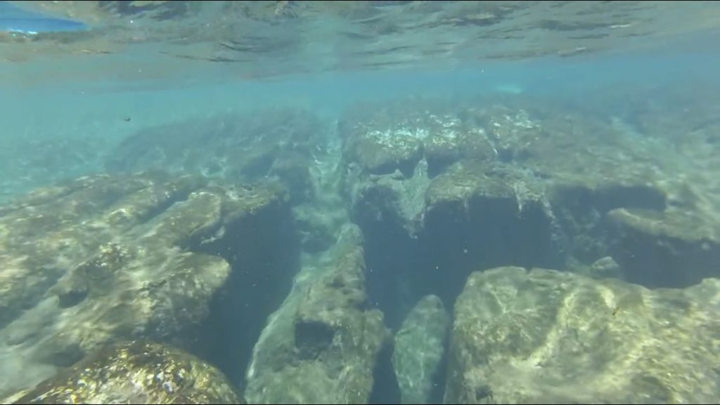 snorkeling underwater view of rock formation at Salt Springs