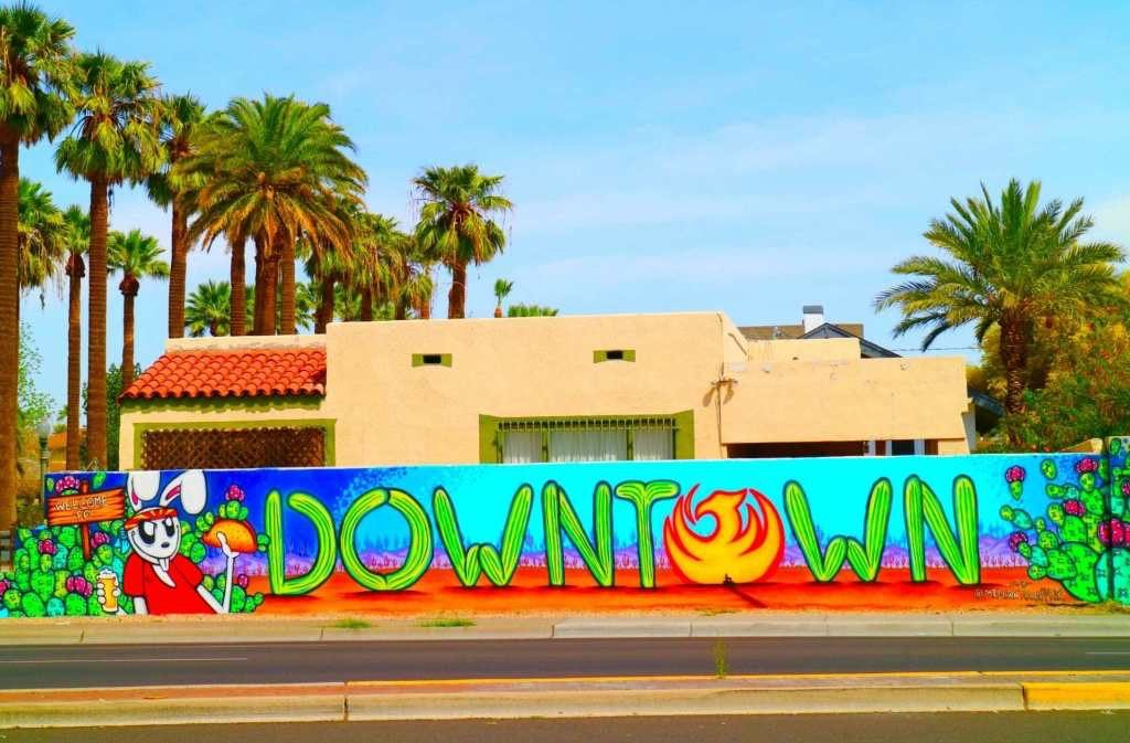 Painted wall that says downtown
