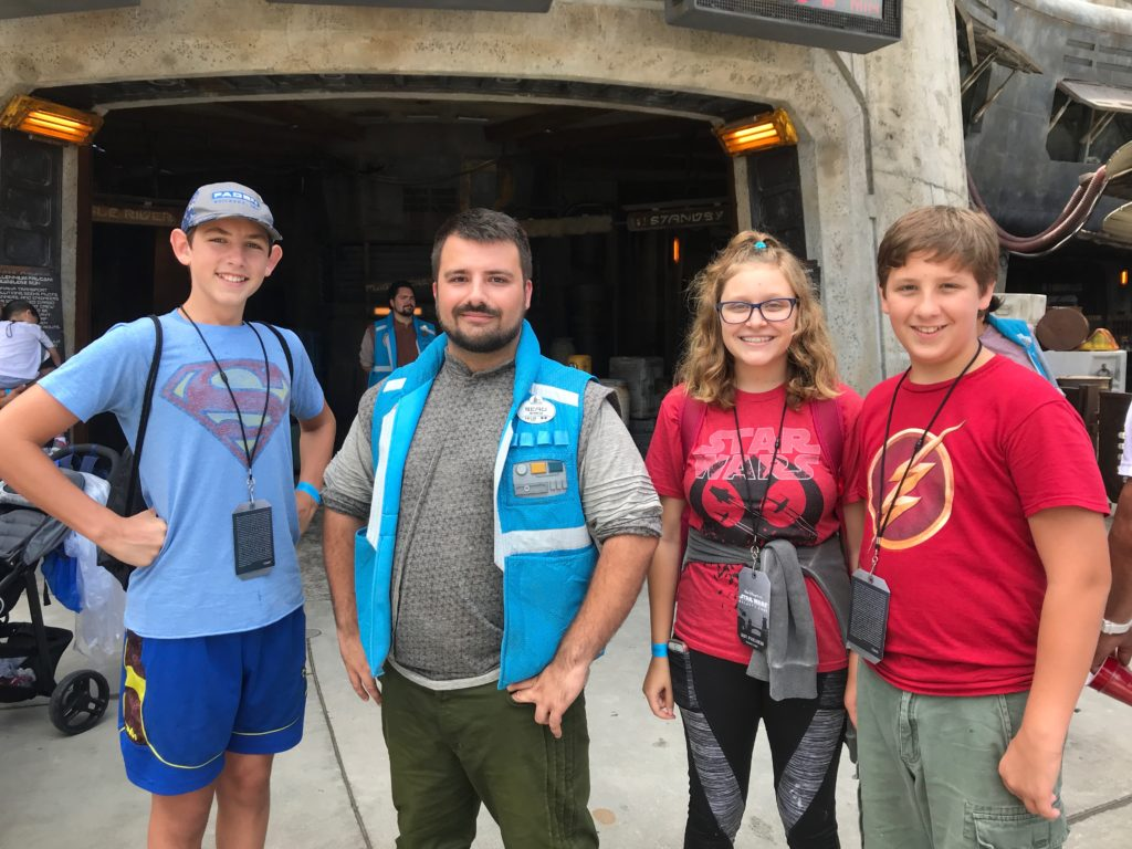Visitors posing with cast member in Galaxy's Edge