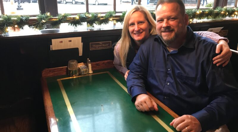 Couple sitting in proposal booth in Martin's Tavern