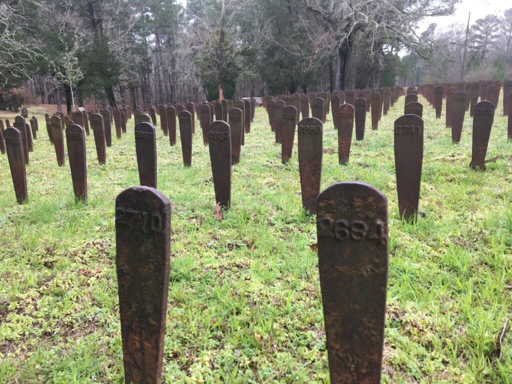 Copper grave markers at Cedar Lane Cemetery