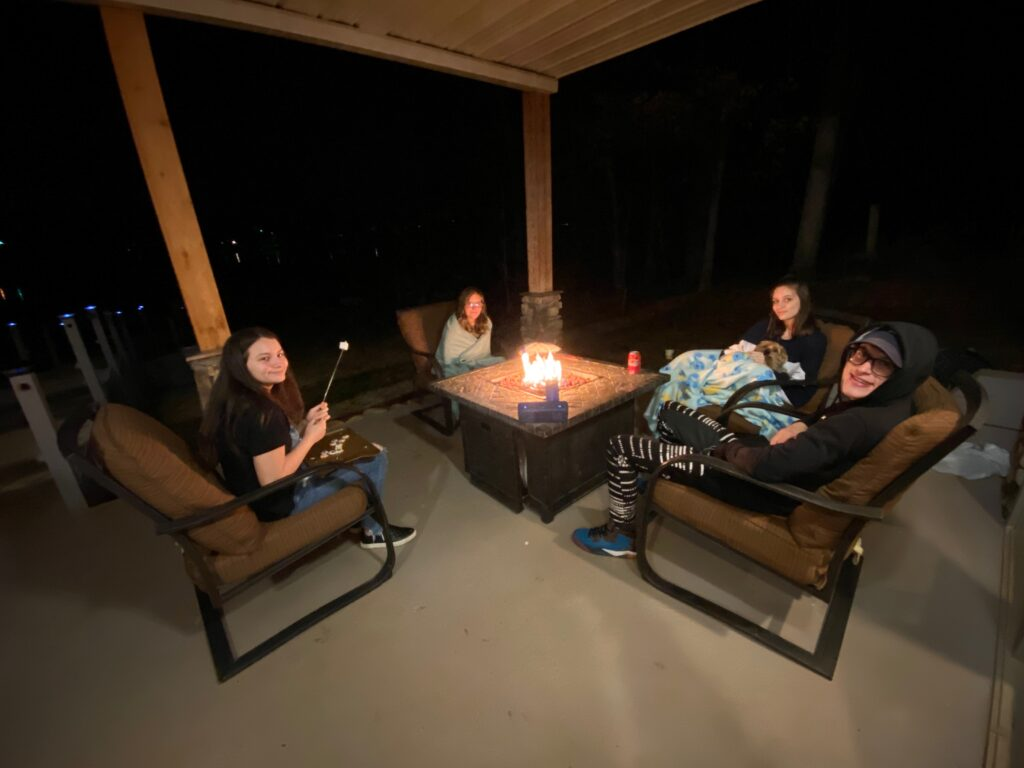 Teens roasting marshmallows at Southern Water's Retreat