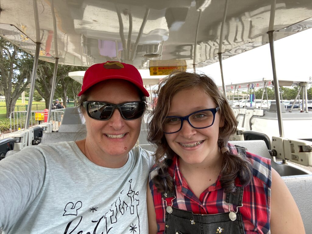 Mom and daughter on tram at Magic Kingdom
