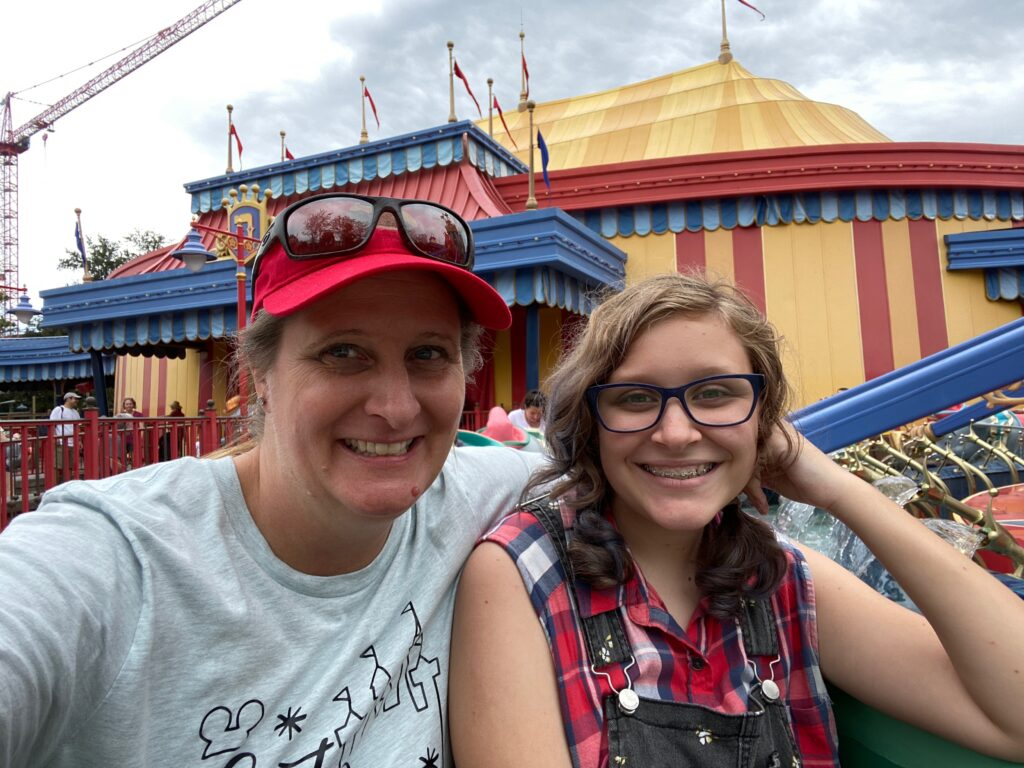 Mom and daughter on Dumbo Flying ElephantsMagic Kingdom Original Attraction