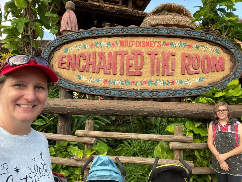 Magic Kingdom Original Attraction Enchanted Tiki Room with mom and daughter in front
