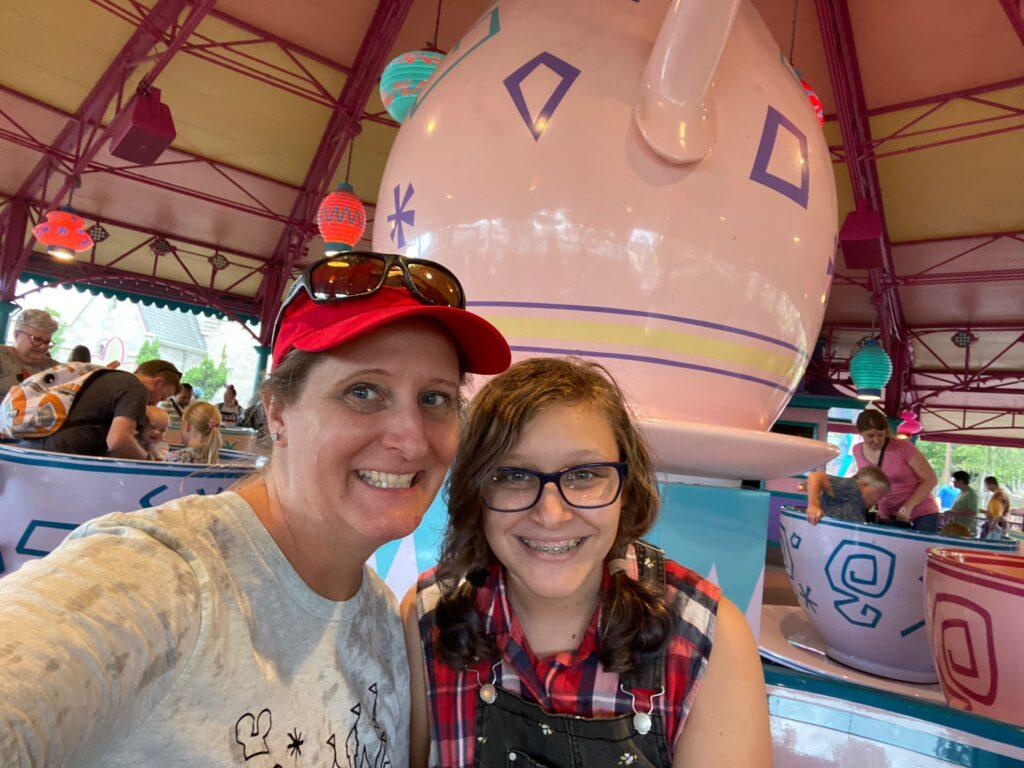 Magic Kingdom Original Attraction Mad Hatter Tea Party with mom and daughter