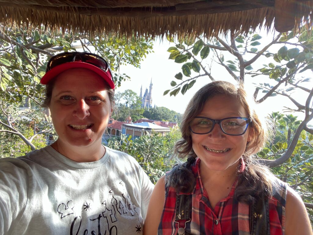 Magic Kingdom Original Attraction Swiss Family Treehouse with mom and daughter overlooking castle