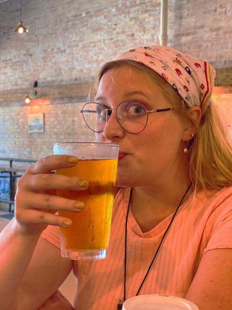 Girl with glass of cider at Harbor Light Brewery