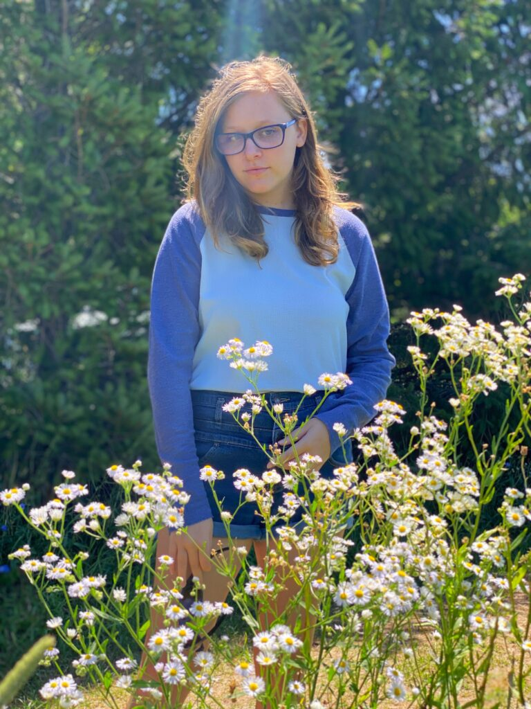 teen girl in flower field outside South Haven