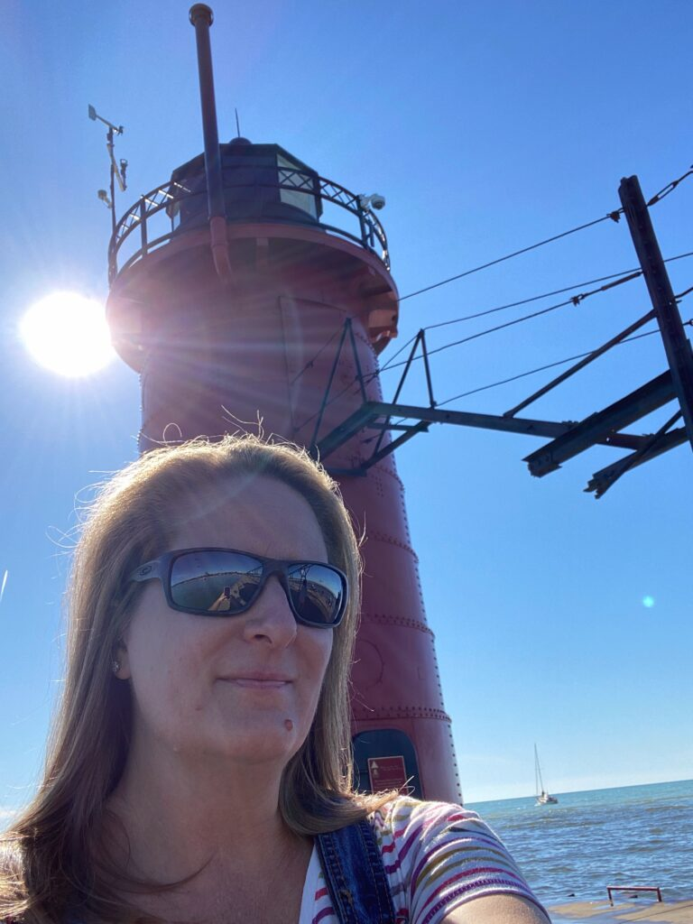 Woman and South Haven Lighthouse selfie